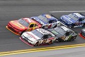 Daytona Beach, FL - Feb 22, 2014:  Regan Smith (7) holds off rest of the field to win the DRIVE4COPD