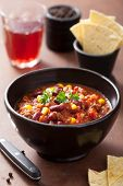 mexican chili con carne in black bowl