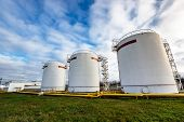 stock photo of refinery  - Big industrial oil tanks in a refinery base - JPG