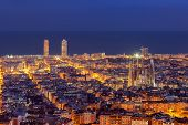 stock photo of oval  - Barcelona skyline at night just after blue hour - JPG