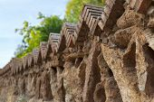 picture of old stone fence  - Fence of old stones in a park in Barcelona Spain.
