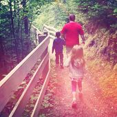 stock photo of instagram  - Father waling with children outdoors  - JPG