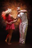 foto of tango  - Young couple dances Caribbean Salsa - JPG