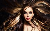 stock photo of hair motion  - close up portrait of young brunette woman - JPG
