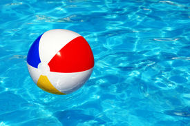 picture of pool ball  - Beach ball floating in swimming pool abstract concept for summer vacations - JPG
