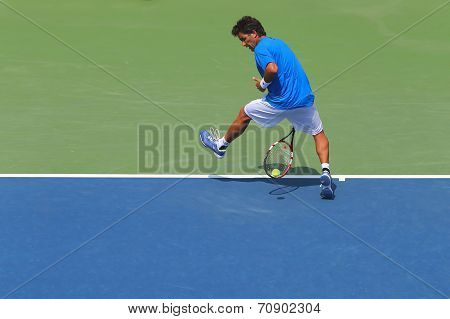 Professional tennis player Massimo Gonzales using Tweener during second round match at US Open 2014