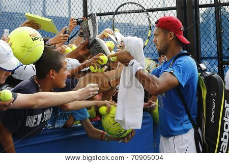 Professional tennis player Jo-Wilfried Tsonga signing autographs after practice for US Open 2014