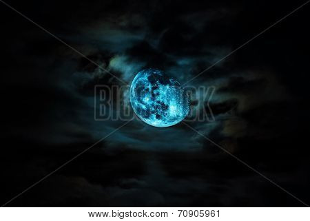 An Dramatic Moon and cloud in low light .