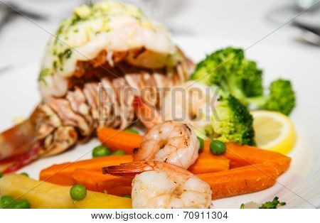 Shrimp With Lobster Tail In Background