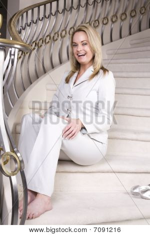 Sitting On Stairs With A Smile