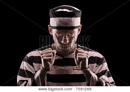 Angry prisoner with handcuffs