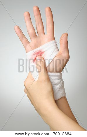 Injured Hand With Bloody Bandage