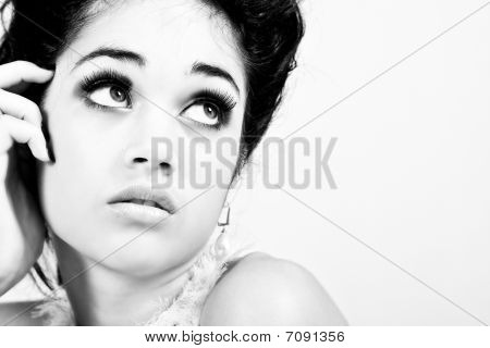 Glamorous Young Woman Looks To The Side. Isolated