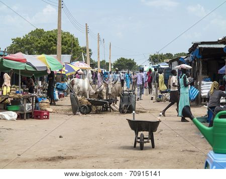 BOR, SOUTH SUDAN-OCTOBER 30 2013: Unidentified people shop in the open air market in Bor, South Sudan
