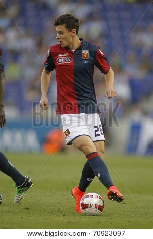 BARCELONA - AUG, 17: Davide Marsura of Genoa CFC in action during a friendly match against RCD Espanyol at the Estadi Cornella on August 17, 2014 in Barcelona, Spain