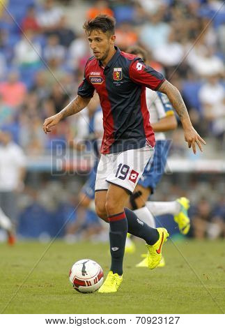 BARCELONA - AUG, 17: Leandro Greco of Genoa CFC in action during a friendly match against RCD Espanyol at the Estadi Cornella on August 17, 2014 in Barcelona, Spain