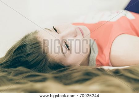 mysterious beautiful young woman lying down