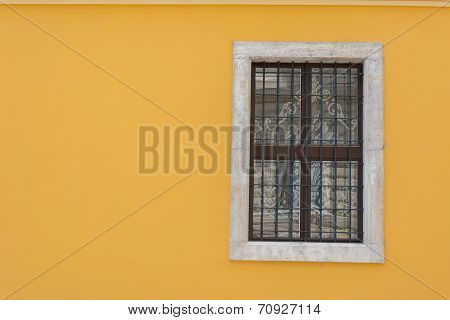 Yellow Wall With Wrought Iron Window