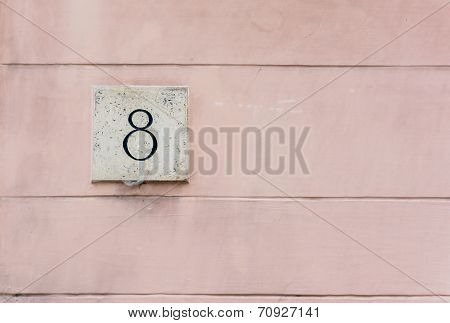 Pink Colored Wall With Number Eight Plaque