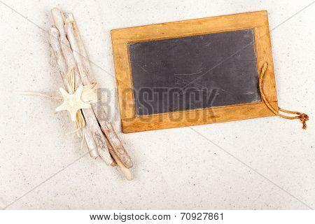 Driftwood And Slate Blackboard In The Sand