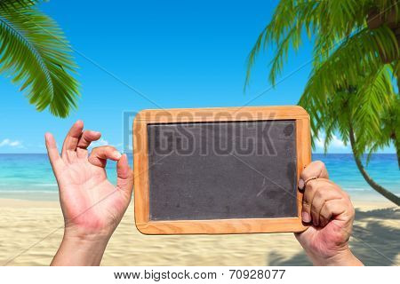 Human Hand Shows Ok Sign And Hold A Slate