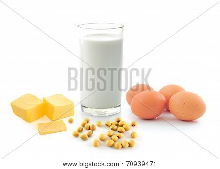 Milk With Soy Beans Stick Of Butter And Egg On White Background