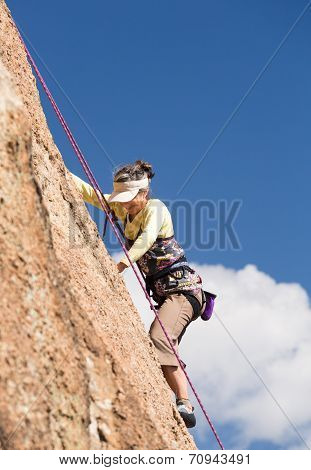 Senior Lady On Steep Rock Climb In Colorado