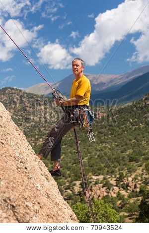 Senior Man Rappelling In Colorado