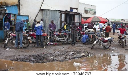 JUBA, SOUTH SUDAN-JUNE 22 2012: Unidentified motorcycle taxi drivers wait for riders in Juba, capital of South Sudan