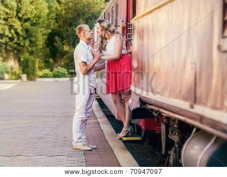 Love couple farewell moment on the retro railway Station