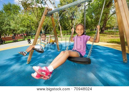 Kids swinging on playground