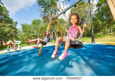 Kids swing on playground
