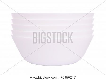 Front five round ceramic bowls stack on white background.