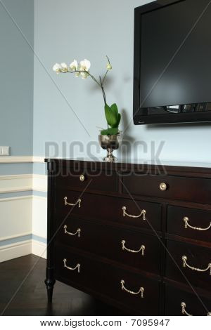 flowers on the chest of drawers