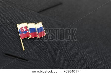 Slovakia Flag Lapel Pin On The Collar Of A Business Suit