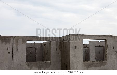 Unfinished Grey Concrete Building In The Construction Site