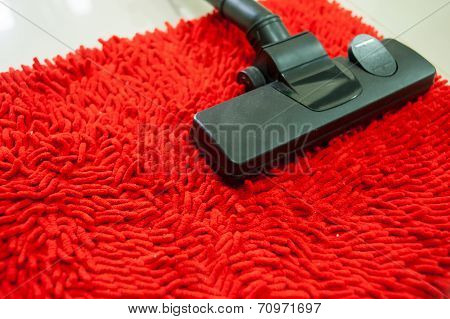 Vacuum Cleaner On Red Carpet