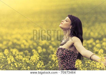 Happy Woman In Ocean Of Yellow Flowers