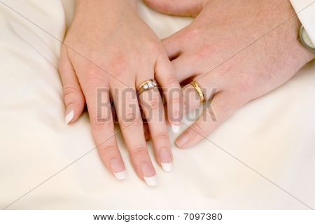 Bride And Groom Holding Hands Showing Wedding Rings Stock photo