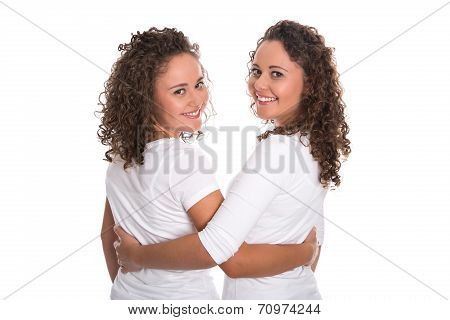 Real Similar Twins With Natural Stop Curls Isolated Over White Background.