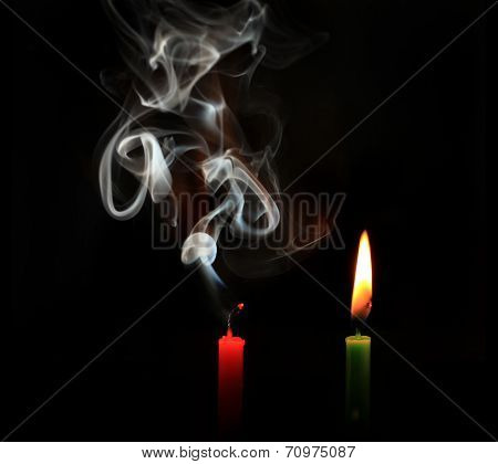burning and extinguished candles