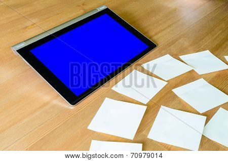 Workplace With Tablet Pc - Blue Box - And Several Sticky Notes
