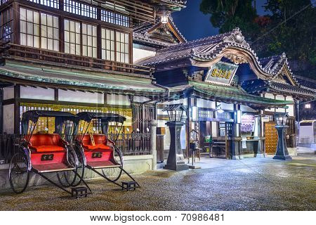 MATSUYAMA, JAPAN - DECEMBER 3, 2012: Dogo Onsen bath house entrance at night. It is one of the oldest  and most celebrated bath houses in the country.