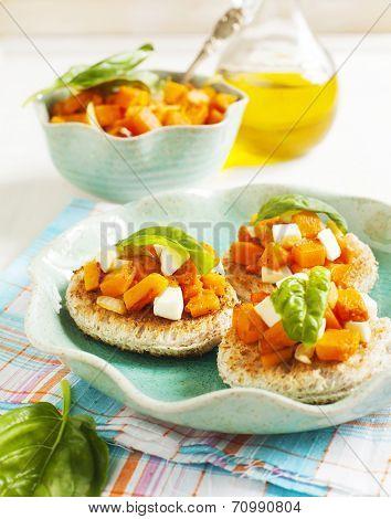 Pumpkin Bruschetta. Bruschetta With Roasted Pumpkin, Cheese And Basil. Selective Focus