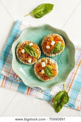 Pumpkin Bruschetta. Bruschetta With Roasted Pumpkin, Cheese And Basil.