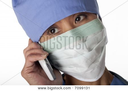 Medical Professional In Scrubs On The Phone