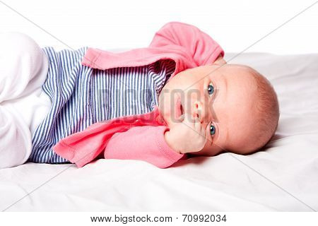 Cute Baby Girl Laying In Crib