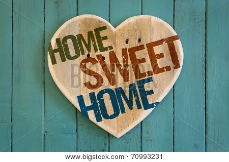Home Sweet Home Message Wooden Heart On Turquoise Painted Background