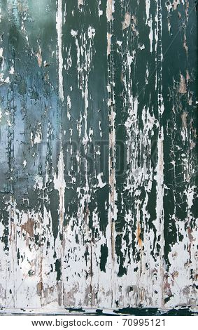 Old wooden surface with green paint peeling off