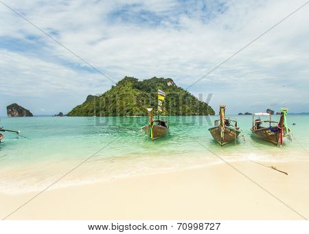 Traditional Thai long tail boat with thai island in the background